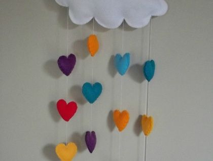Cloud with rainbow hearts or raindrops