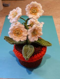 String Theory Crochet: Part 2. How to add crochet compost and flowers to your pot.