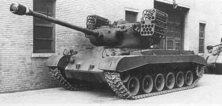 M26 Pershing with T99 rocket launcher mounted on turret.