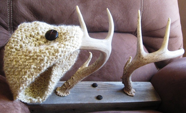 "Custom made 4x4 deer antler clothing rack, created with naturally shed deer antlers found in central South Dakota.     This hand-crafted coat hanger will make a great addition to a home, cabin, shop, shed or office.    Perfect for hanging coats, hats, scarves, ties, jewelry and more, and will hang up to eight individual items.    Measures 15 3/4"" in length and 3.5"" in width, the board 1 1/2"" thick, and stands out 10"" from the wall."