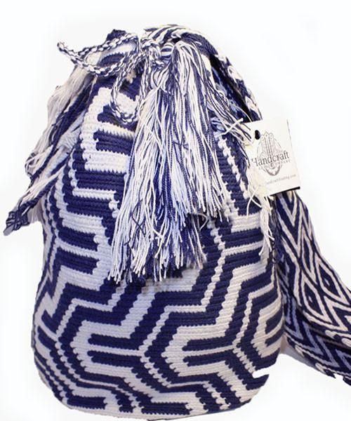 Each of these bags is hand-woven by the tribe's woman artisans using age old traditions. . Each design incorporated into every Wayuu bag is unique to the weaver