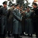 Adolf Hitler, Albert Speer and other high ranking military and political figures in conversation with a decorated German tank crewman