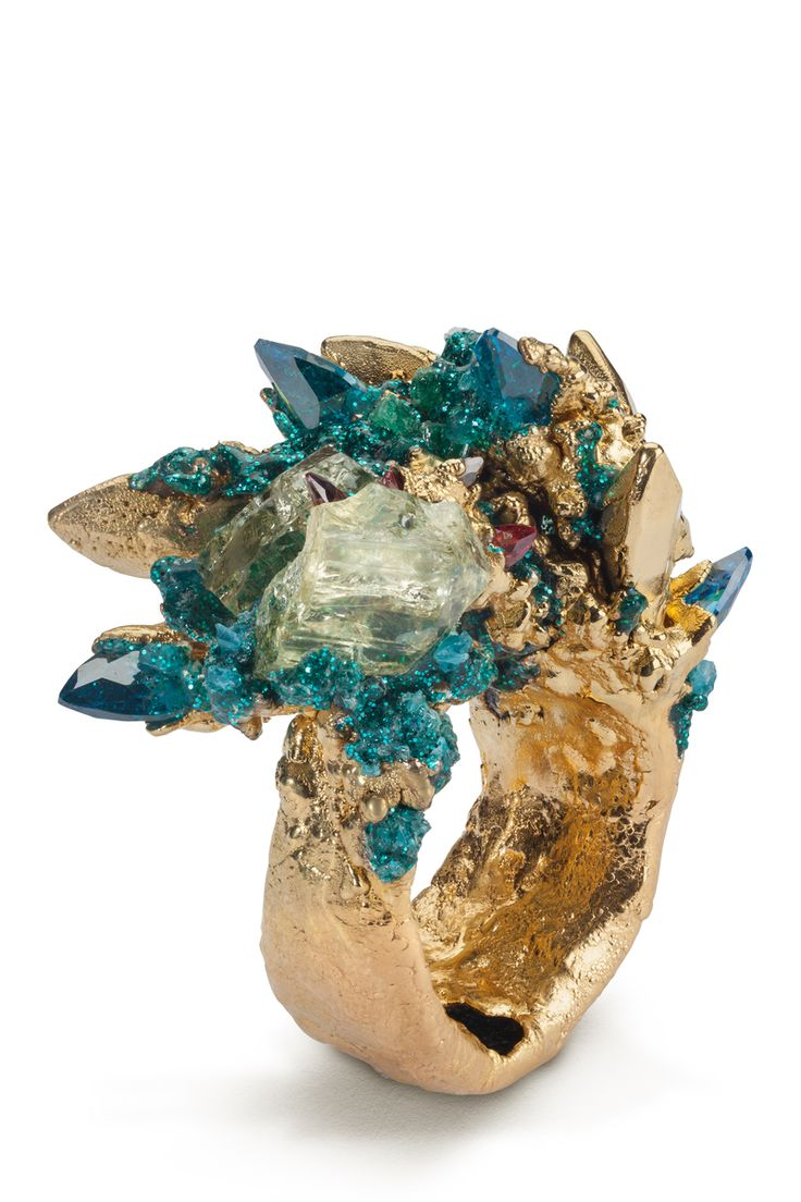 creative wearable art, a stunning ring encrusted with gemstones