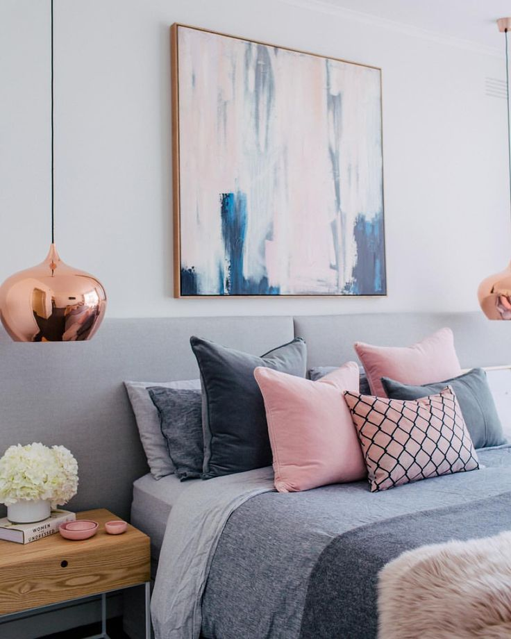 Love the pendant lights and the super wide hupholstered headboard in this contemporary modern bedroom | abstract art | grey + pink | @adoremagazine