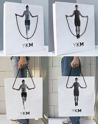 YKM uses shopping bags as a way to market their product. This really captures the idea of guerrilla marketing because it connects with the user while keeping them on their toes!