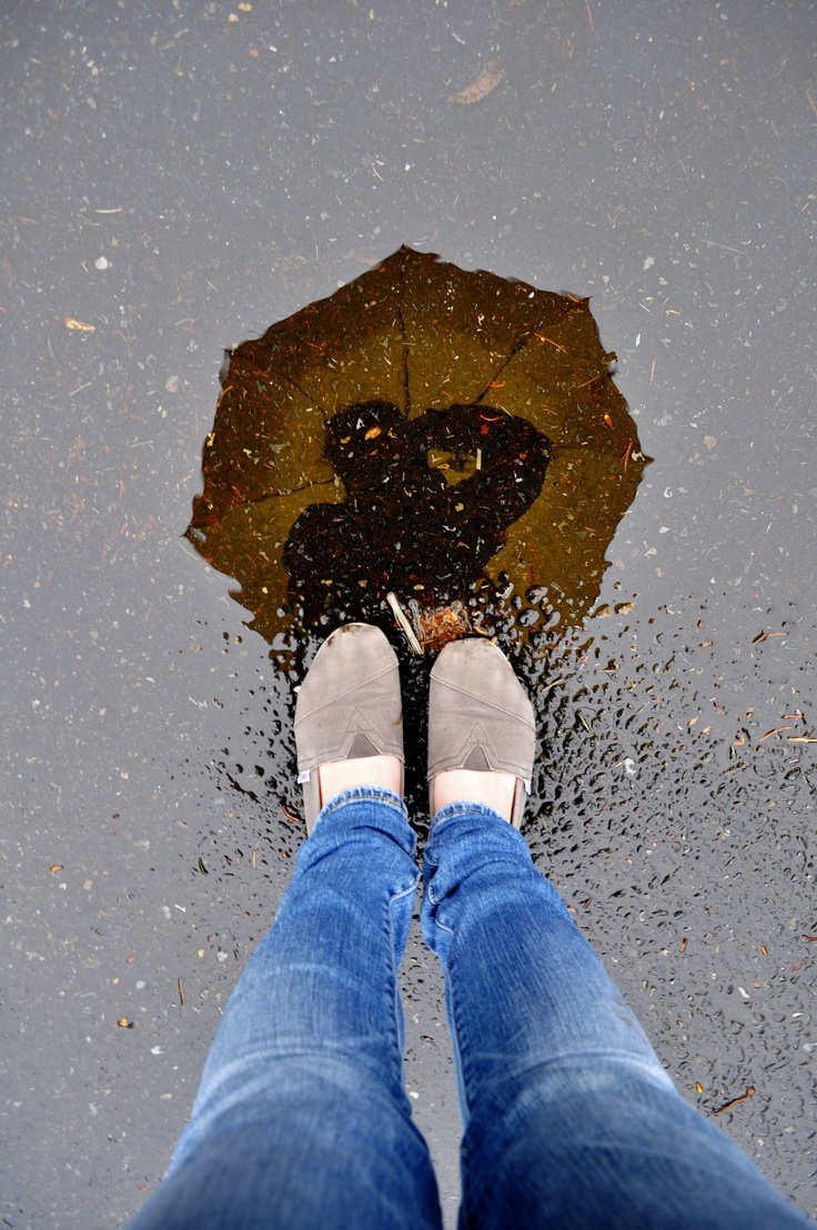 This is just a very cool picture with the reflection of the umbrella in it! Love it!