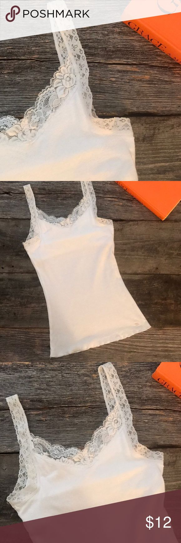 || A & F || Cotton Lace Camisole with Shelf Bra 100 % white cotton camisole with lace straps. Built in shelf bra. This top is in excellent used condition - hand washed and line dried to keep colour and shape. Great for layering. Abercrombie & Fitch Tops Camisoles