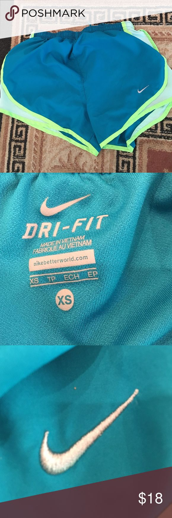 Blue Nike dri fit shorts Blue and electric green dri fit shorts size xsmall never worn and no damages Nike Shorts