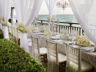 All-white table at intimate beach wedding reception