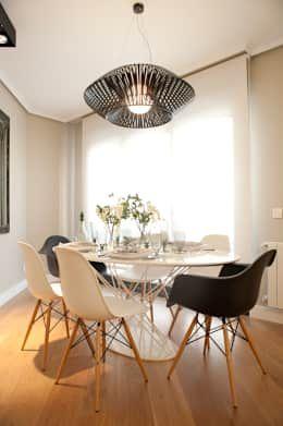 Sala da pranzo in stile in stile Moderno di Sube Susaeta Interiorismo - Sube Contract Bilbao