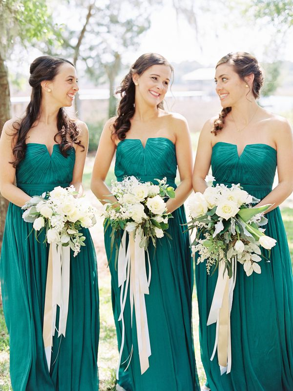 Add long streaming ribbons is varying widths to add dimension to your bridesmaid's bouquets.  Photo by: Nancy Ray #wedding #bouquet #bridesmaid