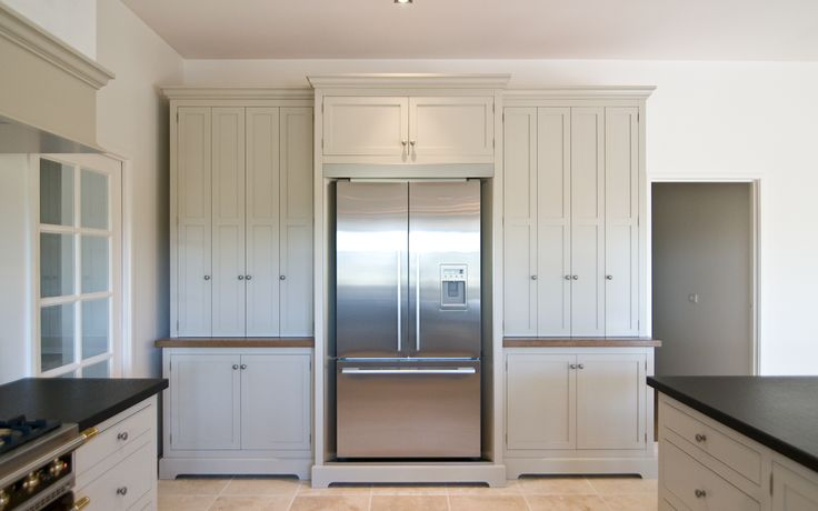 Pleasing to the eye, this symmetrical fridge pantry unit is a highlight in this traditional Hampton style kitchen.