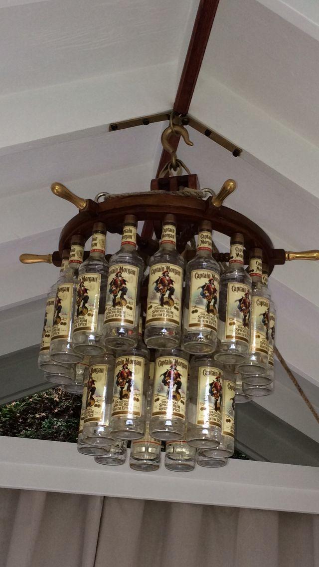 Best 25 ship wheel ideas on pinterest anchor tattoos anchor captain morgan bottle ship wheel chandelier mozeypictures Gallery