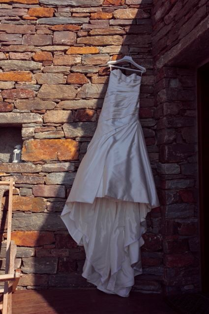 Phootography of the wedding dress out of Afros Suites. Wedding preparation at Aigis Suites in Kea Island of Cyclades in Greece
