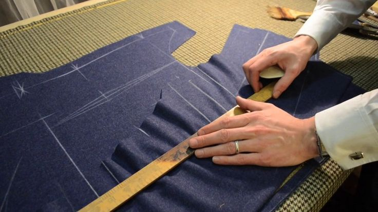 Master tailor Rory Duffy shinks the cloth, chalks the pattern, and cuts the pieces for a handcraft bespoke suit coat.