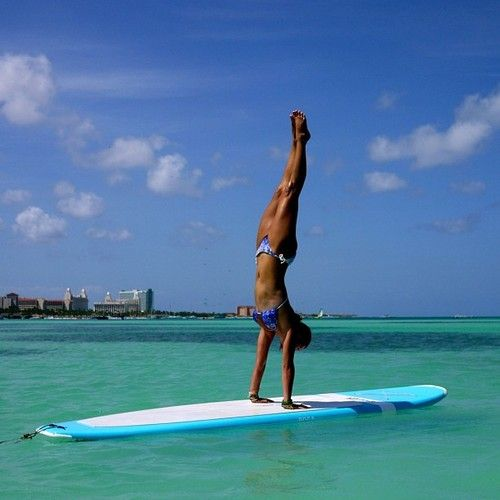 Paddle board handstand-the balance and strength are astounding!