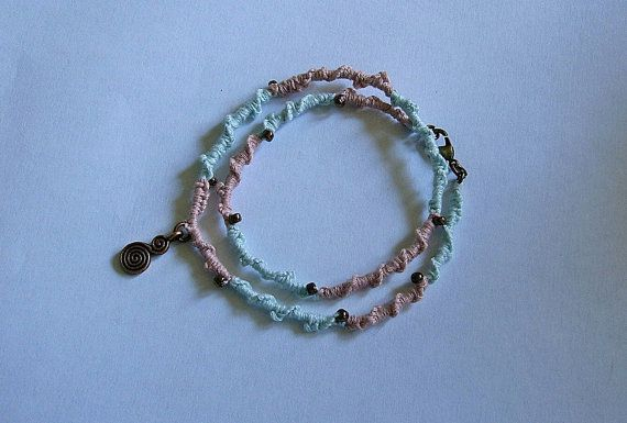 SHABBY CHIC WRAP BRACELET IN DUSKY PINK AND TURQUOISE WITH COPPER SWIRL CHARM.. $17.99, VIA ETSY.