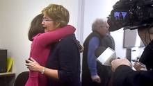 Wanda Morris (L), CEO of Dying With Dignity, hugs admin staffer Saba Khan (fuchsia dress)seconds after the Supreme Court of Canada announced that Canadian adults who are mentally competent and suffering intolerably and permanently, have the right to doctor assisted dying after the Court's judgement was released on Feb 6 2015. A press conference aaas held at Dying With Dignity, a charity that helps people with their end of life decisions.