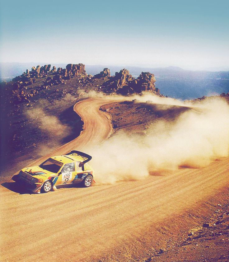 A Peugot kicking up some dust