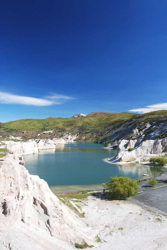 The Blue Lake at St Bathans in Central Otago, New Zealand. The lake was created by gold miners who used sluice guns to convert what was once Kildare hill into  a lake!