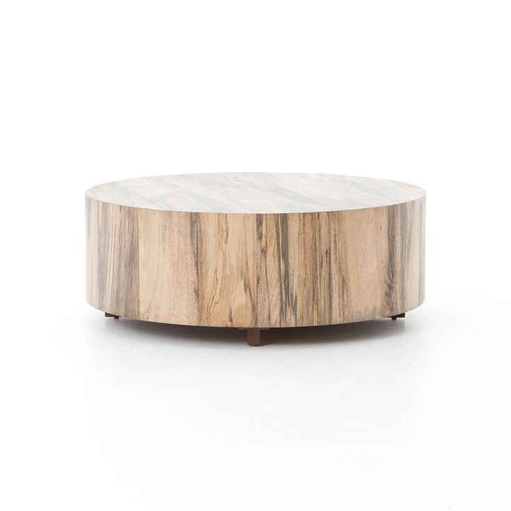 Primavera wood is hand-shaped into a simple cylindrical silhouette and then placed over an oxidized iron base to create this Hudson Round Coffee Table.
