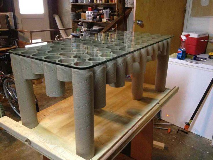 Cardboard tube coffee table by Sam Raske Designs . #reuse #repurpose #recycle #cardboard #tube