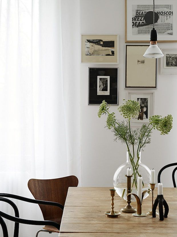 vintage dining table and a simple vase of flowers in a Stockholm pad with a mix of vintage and designer pieces. Kristofer Johnsson / Josefin Hååg. Residence.