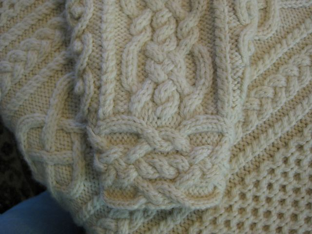 Ravelry: Diamond Rings Aran pattern by Catherine Berry So many beautiful details on this sweater!