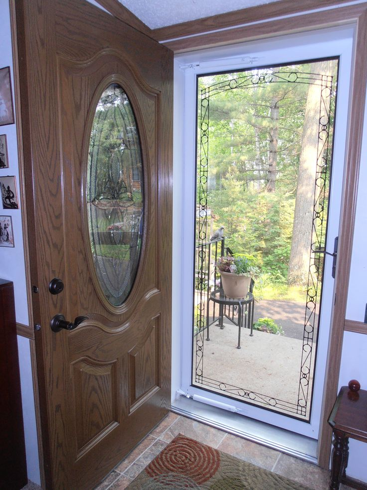 2015_0615 Newly Installed Fiberglass Front Door And Full View Larson Storm  Door With Embedded Border In