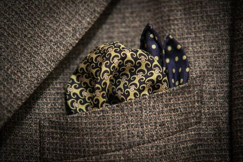 Two pocket squares in one pocket - blue spotted pocket square, patterned pocket square.