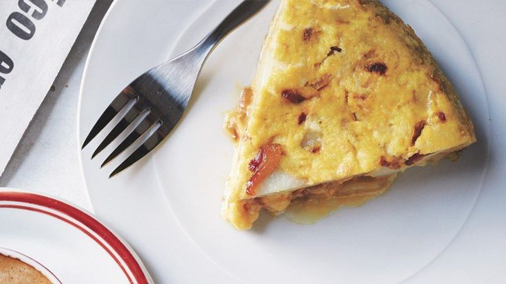 Here's your chance to master one of Spain's classic tapas: tortilla española. The key is to leave the eggs slightly undercooked; that's what gives this a custardy (not bouncy) texture.