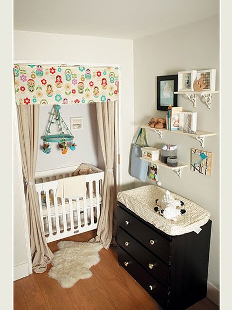 """""""The nook nursery -- fitting baby's crib into a closet -- is a big trend for 2012. These Brooklyn, NY parents made use of every inch of their small space by creating a compact baby corner -- the crib goes in the closet and is flanked by a changing pad topped dresser.  """"DIY Tip: We love how baby's crib nook has been turned into a dramatic """"event"""" with the beautiful, valance and curtains framing the bed. So sweet and easy to re-create!"""""""
