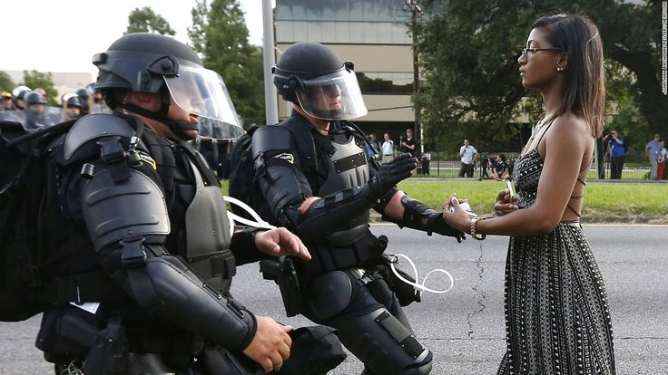 Reuters photographer's image of woman's silent protest in Baton Rouge is image of grace under pressure, memorably arresting, but it's too early to call it iconic.