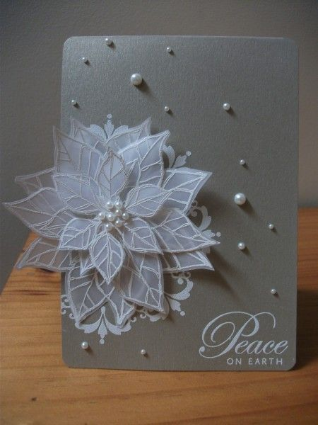 handmade Christmas card ... gorgeous poinsettia ...layers of translluscent vellum petals embossed in white ... scattering of pearls on gray base card ... Stampin' Up!