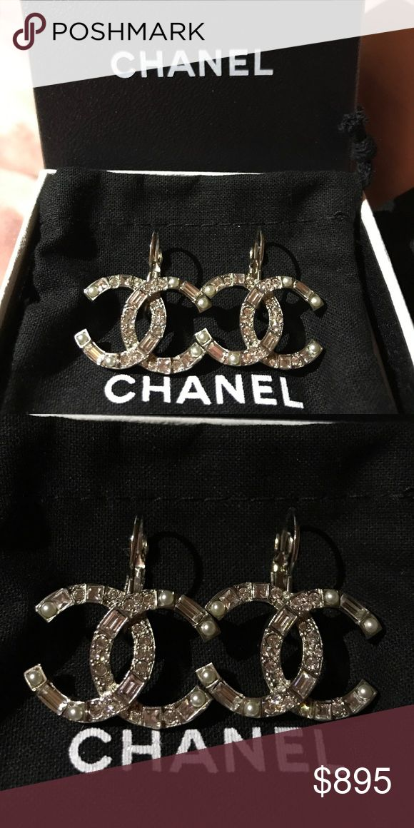 CHANEL SILVER CRYSTAL WITH PEARL DANGLE EARRINGS NEW IN BOX 💯 % authentic CHANEL SILVER CRYSTAL WITH PEARL CC LOGO DANGLE EARRINGS CLASSIC                                                                  Condition : Brand new & Excellent condition.                All my items are 100% authentic, please check my selling history. Price negotiable CHANEL Jewelry Earrings