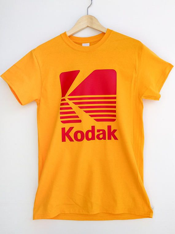Made with Gildan Ultra Cotton pre-shrunk high quality screen printed t-shirt featuring a vintage Kodak logo on front of shirt.  Available in Golden Yellow.  Sizes available are S, M, L, XL, and XXL (2XL).  Perfect for any photography fan.  Shipping in Canada and the United States is