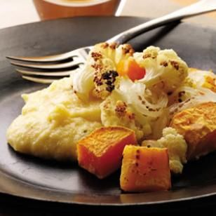 Creamy polenta laced with sharp Parmigiano-Reggiano makes a savory bed for sweet roasted vegetables.