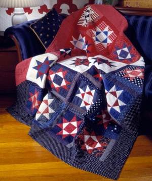 scrappy red, white, and blue Ohio Star Quilt