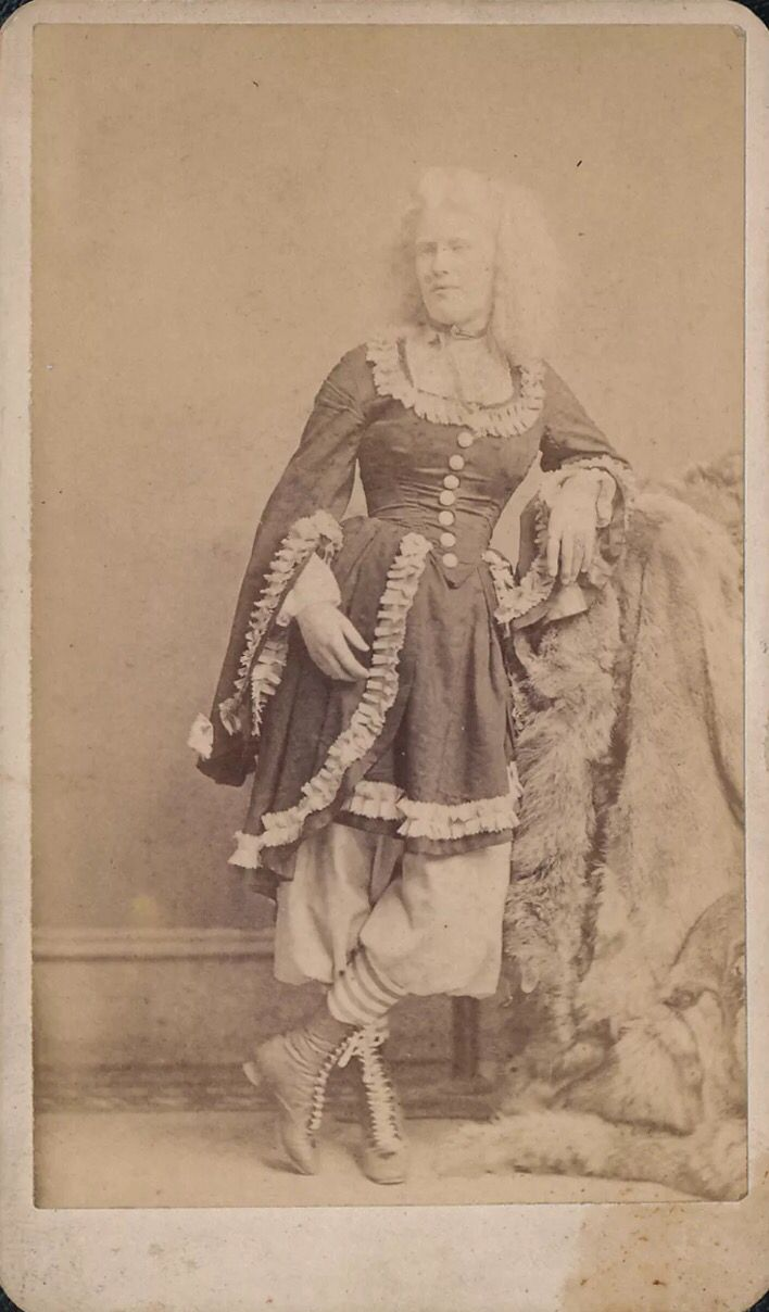 """Albino Circassian woman named Zulia Lutti. Circassians used these exotic names to add to the mystic of their fictitious homeland of """"Circassia."""" Here, Zulia stands in all her glorious sideshow attire, which was considered quite risque for the day, but added to their appeal to male onlookers."""