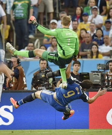 Germany's goalkeeper Manuel Neuer, top, clatters into Argentina's Gonzalo Higuain during the World Cup final soccer match between Germany and Argentina at the Maracana Stadium in Rio de Janeiro, Brazil, Sunday, July 13, 2014.