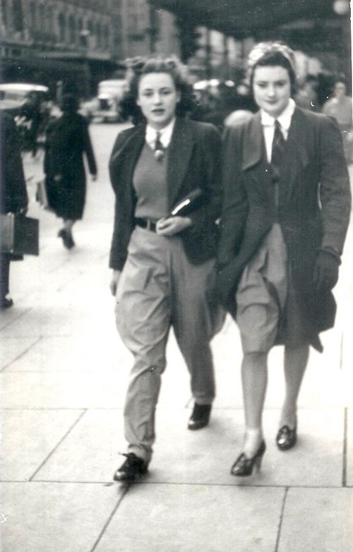 """[from the satorialist: if only it were in sharper focus.]  Submitter says: """"My grandmother, Audrey, age 17, 1939, days before she enlisted in the Air Force. On her right is her younger sister, Amba. On the way to the Tan at the Botanical Gardens for a horse ride, the two were captured walking down Swanson St, Melbourne by a street photographer."""