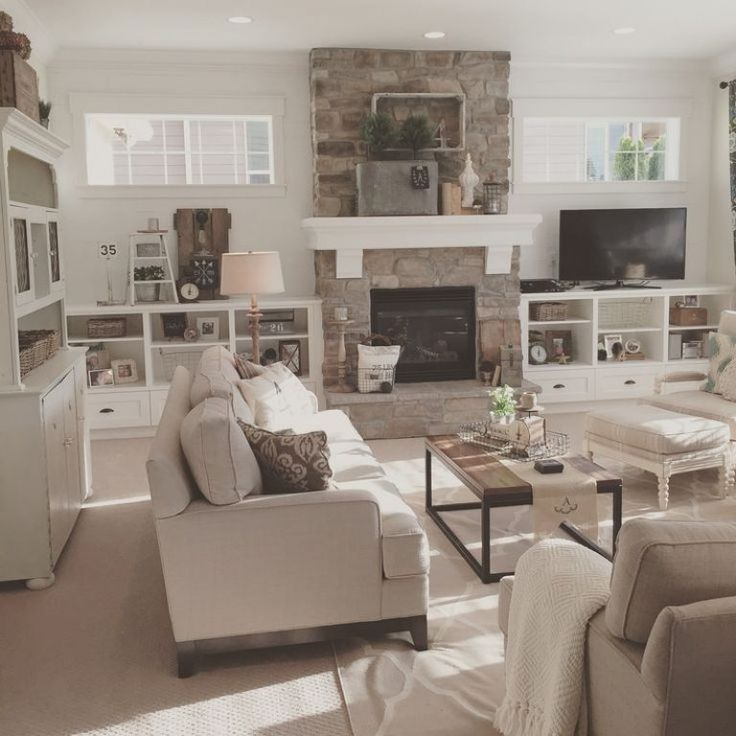 √ full height stone fireplace with white wood mantel, flanking white wood bookcases & transom windows; Chic Farmhouse Interior Design Farmhouse Open Concept Great Room With Modern Farmhouse Style