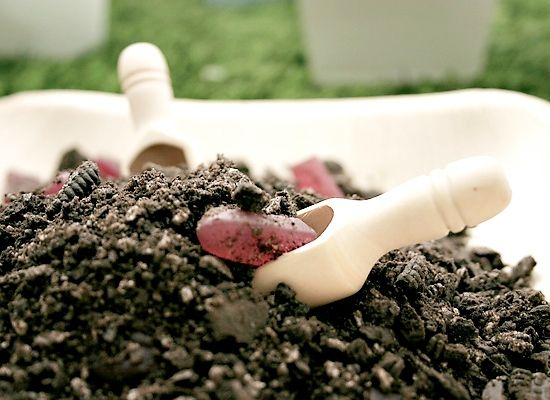 """Worms In Dirt  Worms in dirt..er…. gummy worms in mashed Oreos – even better! This party snack idea might be best for an outdoor garden party, as it might get a little messy, but the kid's will love it! Place small bowls or paper cups by the """"dirt"""" plate so they can scoop up their own little share of awesomeness."""