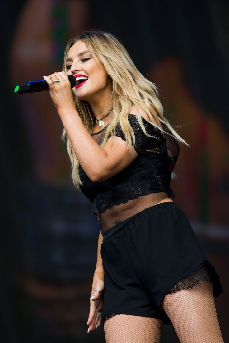 Our Favorite Look of the Day | Twist Monday, July 14: Little Mix's Perrie Edwards looked so cool performing with the band at British Summer Time Festival in London. We love her lace-trimmed shorts and coordinating black crop top!