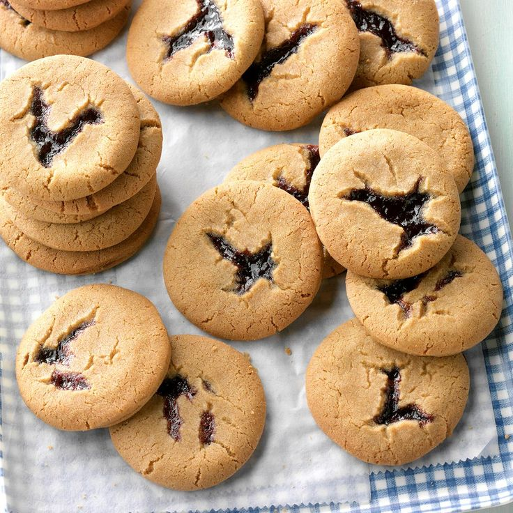 Blackberry Peekaboo Cookies Recipe -My grandmother bakes this recipe every year for the holidays. She uses homemade blackberry jam that she makes fresh every summer. These cookies are so delicious! —Jacquie Franklin, Hot Springs, Montana