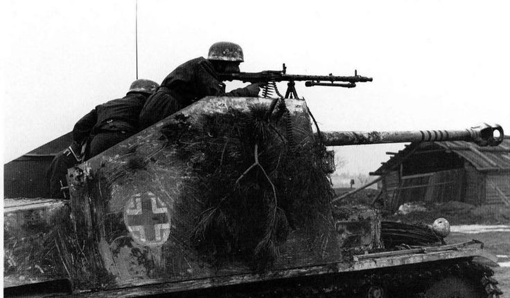 Fallschirmjäger are entering a russian village in a Panzerjäger MARDER II armed with a 75 mm PaK and an MG 34
