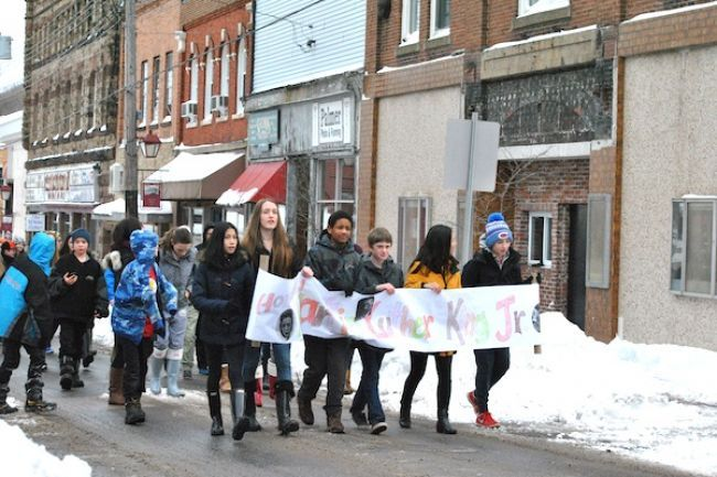 Students from New Glasgow Academy in grades 5 to 8 marched from their school through the downtown area and past the Roseland Theatre, where Viola Desmond took a stand against racial segregation. Monday was Martin Luther King Jr. Day, and the students spent the day honouring him and learning about civil rights.