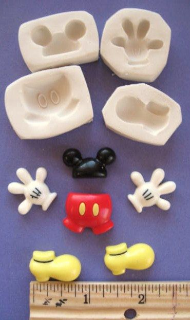 LOT    NONFLEXIBLE  (4 molds)   MICKEY mouse ears hat hand feet body  polymer clay mold molds. $8.99, via Etsy.
