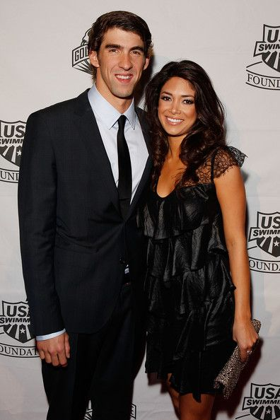 Michael Phelps,   Nicole Johnson  Michael Phelps of the U.S. National Swim Team and Nicole Johnson poses for a photo on the red carpet prior to the 7th Annual Golden Goggle Awards at the Marriott Marquis on November 22, 2010 in New York City.