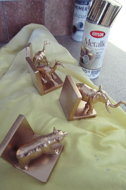 DIY Bookends with painted toys, wood blocks, and super/hot glue